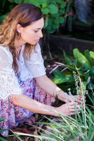 Jo Bell Picking Flower