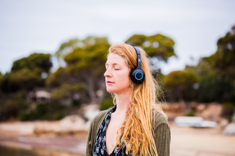 Woman listening to music, relaxing